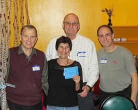 Suzy B. receiving her blue pin from teachers Paul, Clif and Geoff